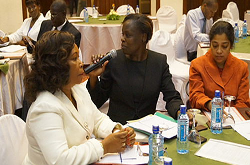 (L-R) Secretary, Children Affairs Lydia Muiru, National Coordinator, SP Secretariat Winnie Mwasiaji and Social Protection Advisor OXFAM, Sumananjali Mohanty at the Stakeholders Forum on Social Assistance Act in Nairobi, on 18 July 2013. In the background are other participants.