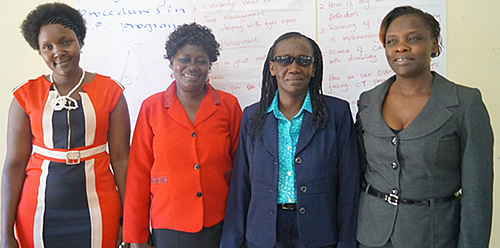 L-R: Busia Gov. County officers, Evelyn, Jecinta, the Executive Officer, Community Development, Sports, Culture & Social Services Busia County Government, Grace Matinde and Winnie Mwasiaji, SPS Coordinator pose for a photo during the Joint SP training in Busia on 11th September, 2013.